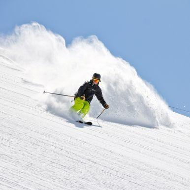 Skier in deep powder, extreme freeride